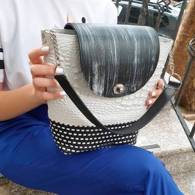 White basket with black flap